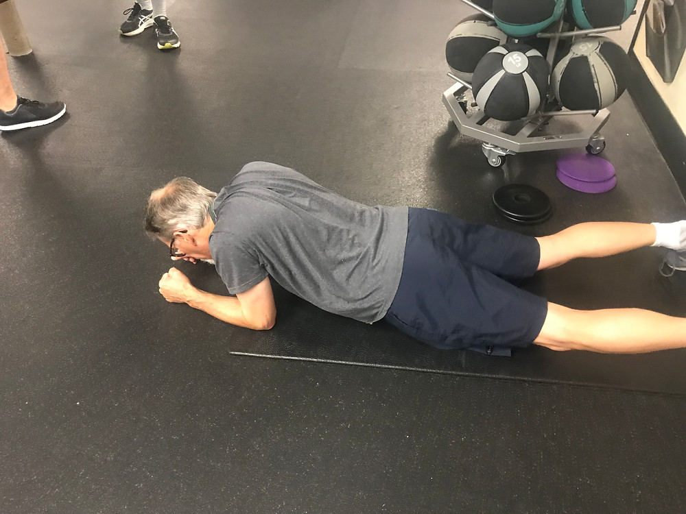Man demonstrates scapula push-ups