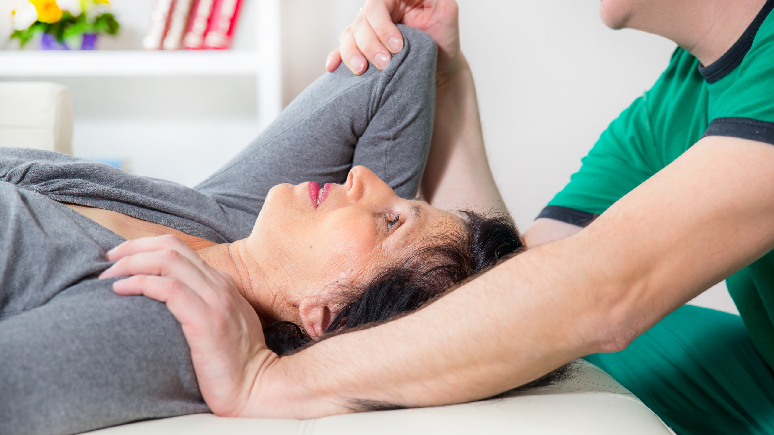 Canva - Chiropractor stretches female pa
