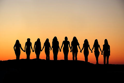 Sunrise silhouette of 10 young women wal