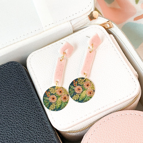Pale pink dangles with floral attachments