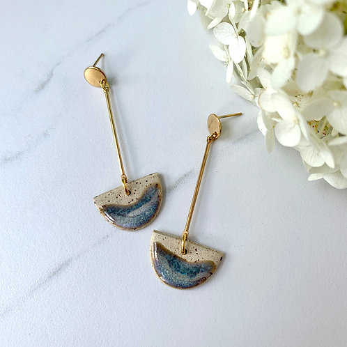 Half moon dangles with soft blues and gold