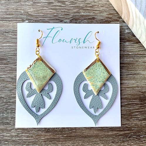 Gold and green statement earrings with grey leather