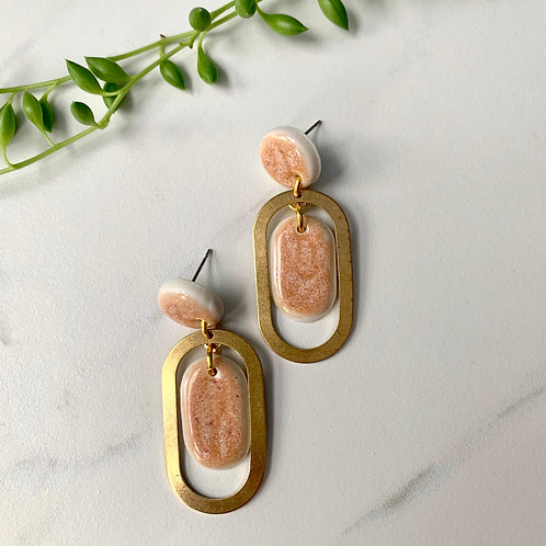 Pale peach with brass ovals