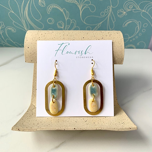 Pale yellow and green with brass ovals