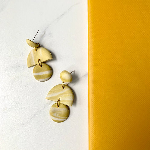 Porcelain and yellow half moons and circles in gold