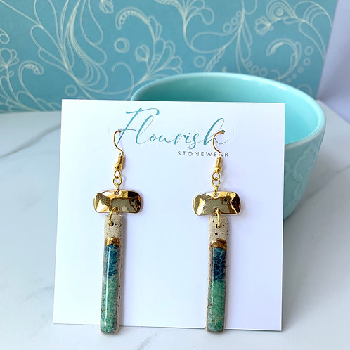 Speckled clay dangles in ocean blues and green with gold