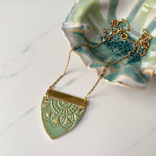 Textured mint green with gold necklace