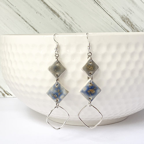 Grey and blue diamond shapes with silver attachments