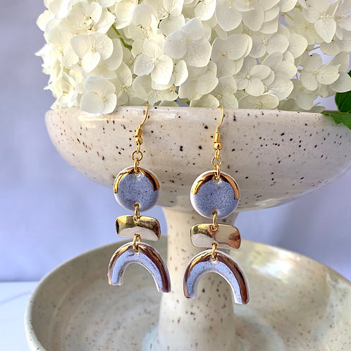 Light violet circles and arches with gold attachments