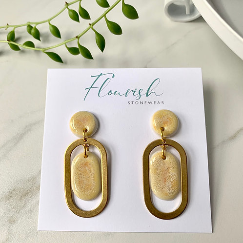Pale yellow dangles with brass ovals