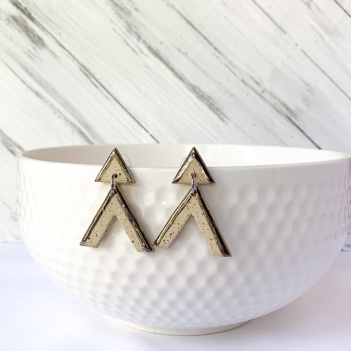 Triangles and arrows in silver