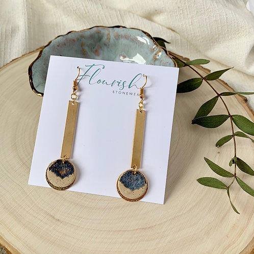 Speckled clay and blue circles with gold accessories