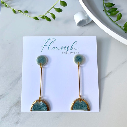 Blue-green arches with circles and gold dangles