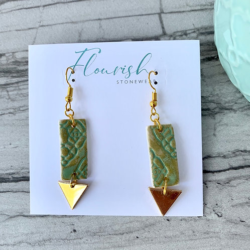 Mint green textured rectangles with gold triangles
