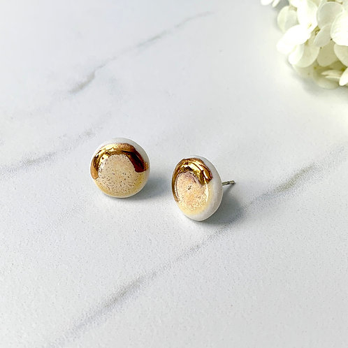 Pale yellow and gold studs