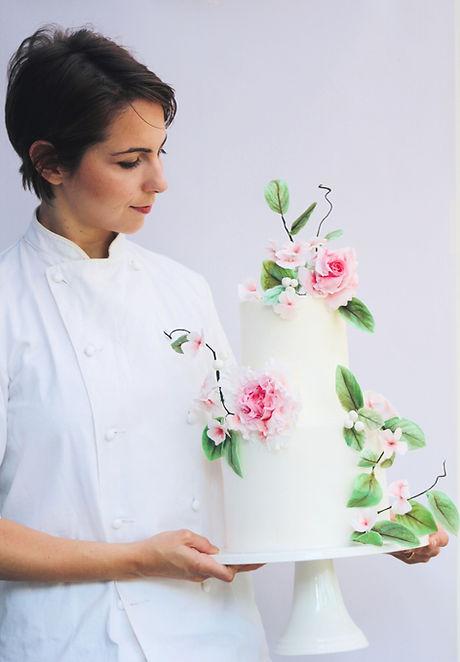 Giulia O'Lorey with two tier cake