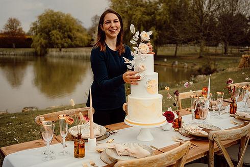 Giulia O'Lorey with yellow marble wedding cake