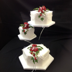 3 tier cake with rose decoration