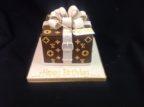 A Louis Vuitton inspired birthday cake in a box shape