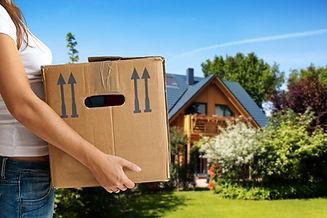 Lady carrying a cardboard box