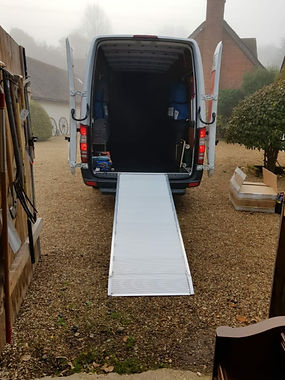 simons man and a van vehicle with rear doors open and ramp.jpg