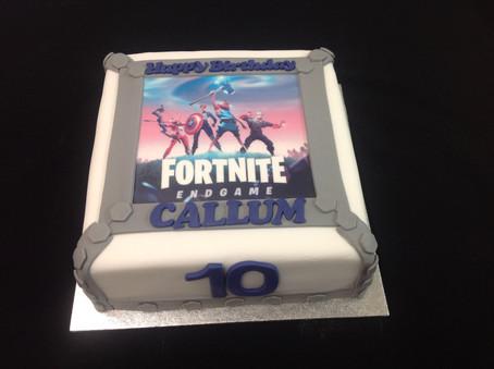 fornite endgame inspired 10th birthday cake with callum written on the edge