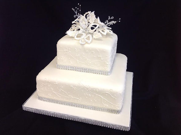 2 tier white cake with floral patterns