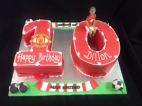 A man united inspired 10th birhtday cake with the number 10 and a player and ball