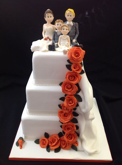 3 tier wedding cake with rose heads from
