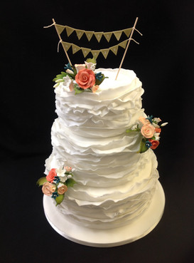 multi tier white cake with floral decorations