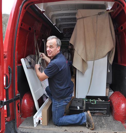 man loading a red Renault van