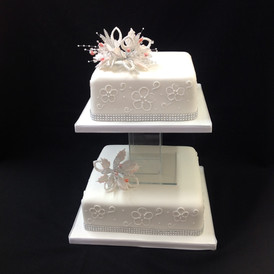 2 tier white cake with floral design