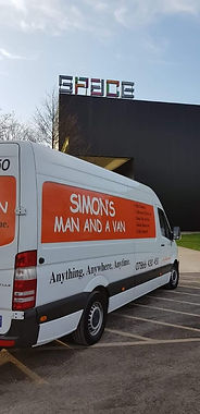 simons man and a van vehicle and building picture.jpg
