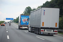 Large trucks driving on road