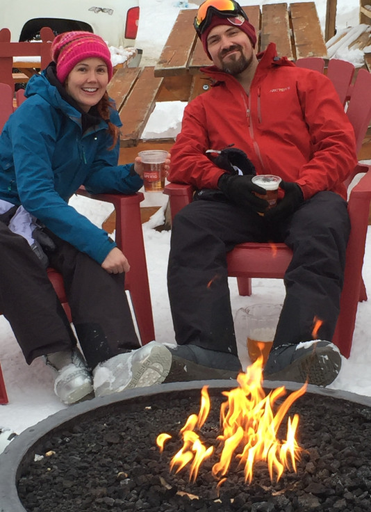 Couple Sitting By the Fire Outside