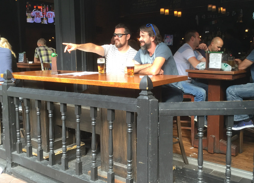 Two guys having beer on the patio