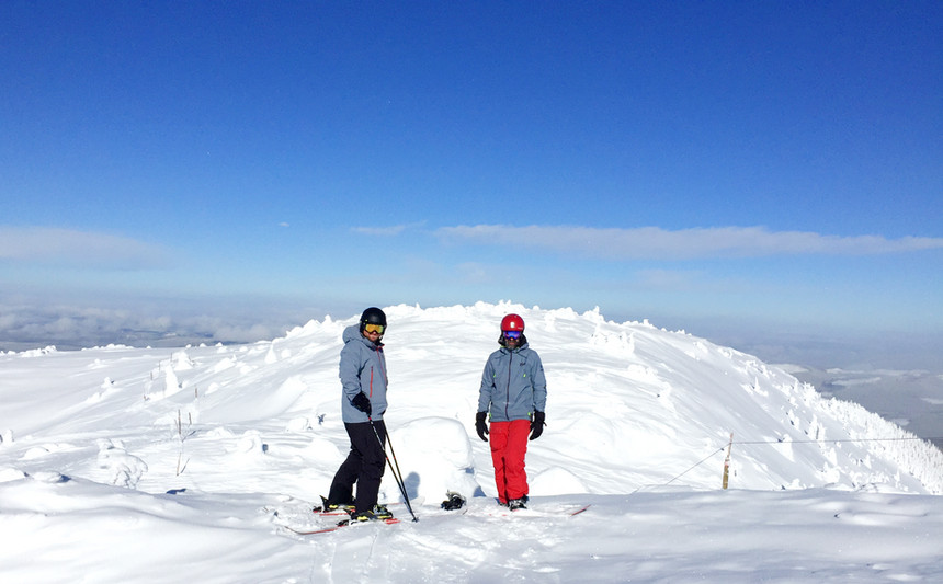 Two Guys Snowboarding