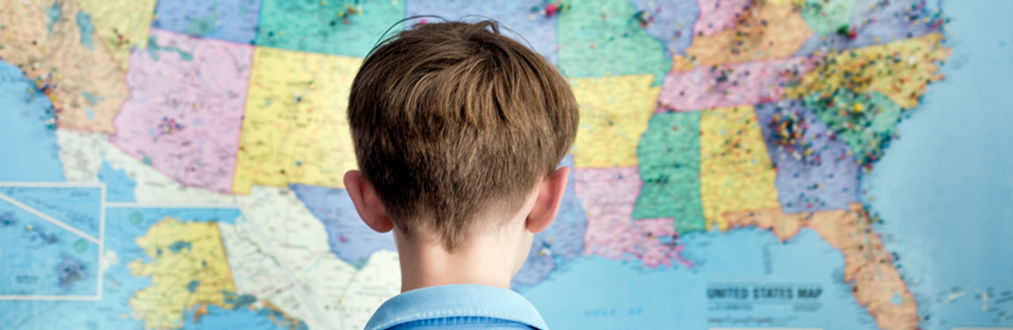 Child in front of map