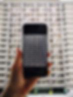 person_holding_black_iphone_5-.jpg