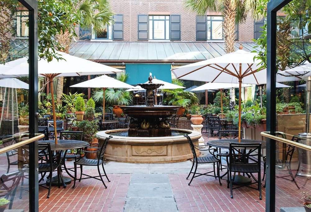 The Palmetto Cafe Courtyard at The Belmond Charleston Place  in historic downtown Charleston, South Carolina