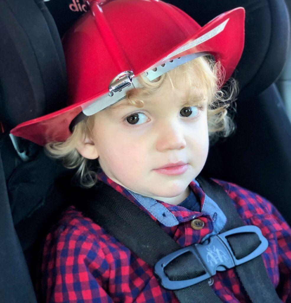 boy in fireman hat