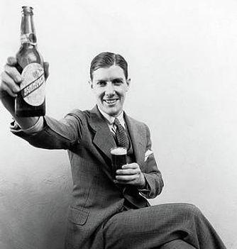 1930s-man-holding-up-huge-distorted-vint