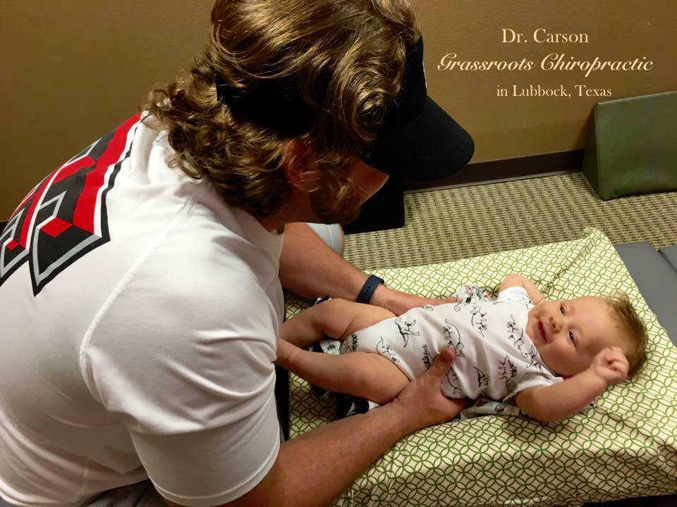 Baby Leo gently adjusted byhis dad Dr. Carson.   Photo courtesy of Dr. Carson at Grassroots Chiropractic in Lubbock, Texas