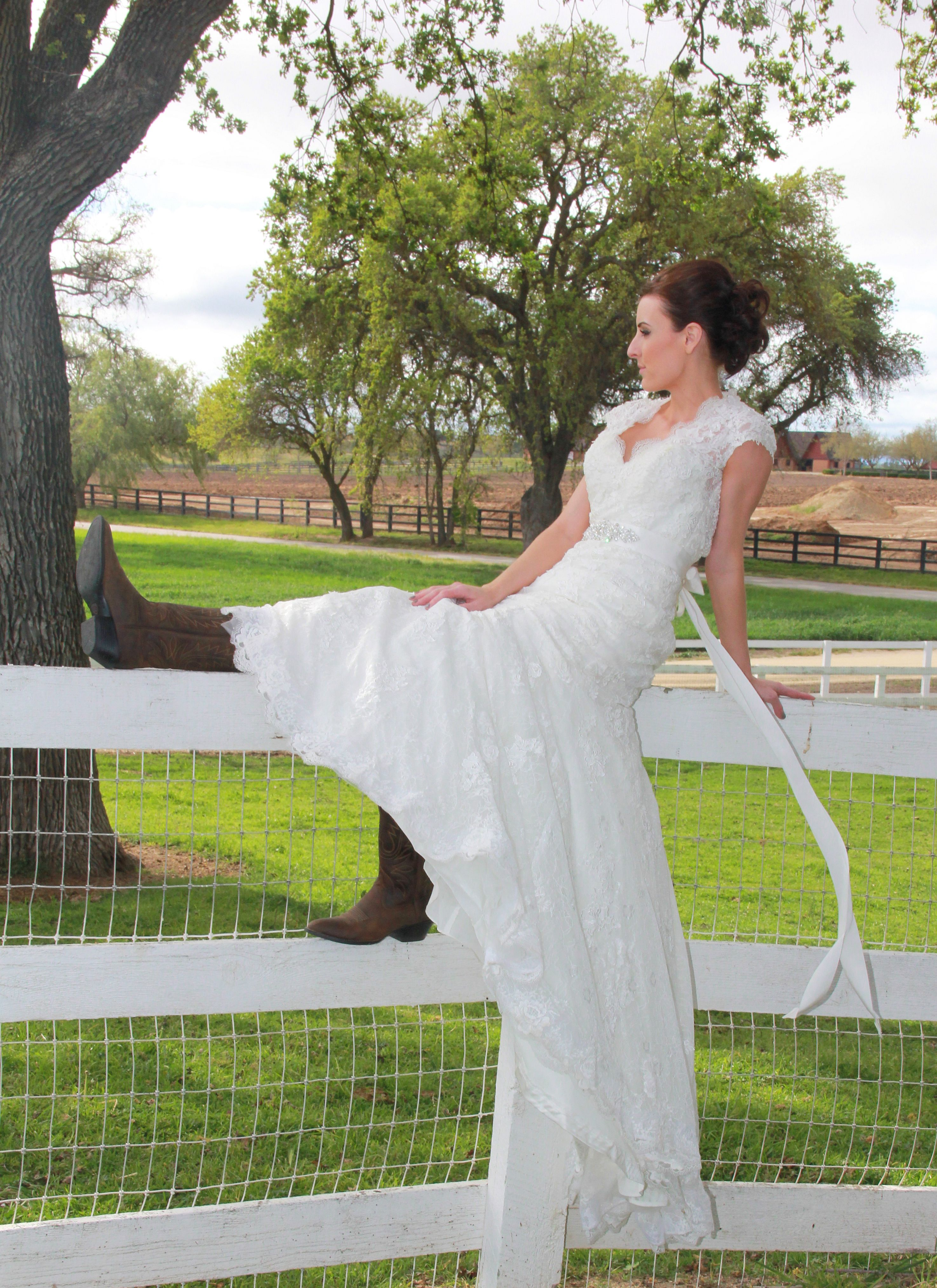 bride sitting on fence