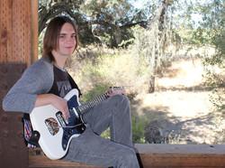 Male graduating senior photo guitar