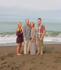 Family photo shoot on the beach