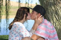 kissing engagement photo shoot