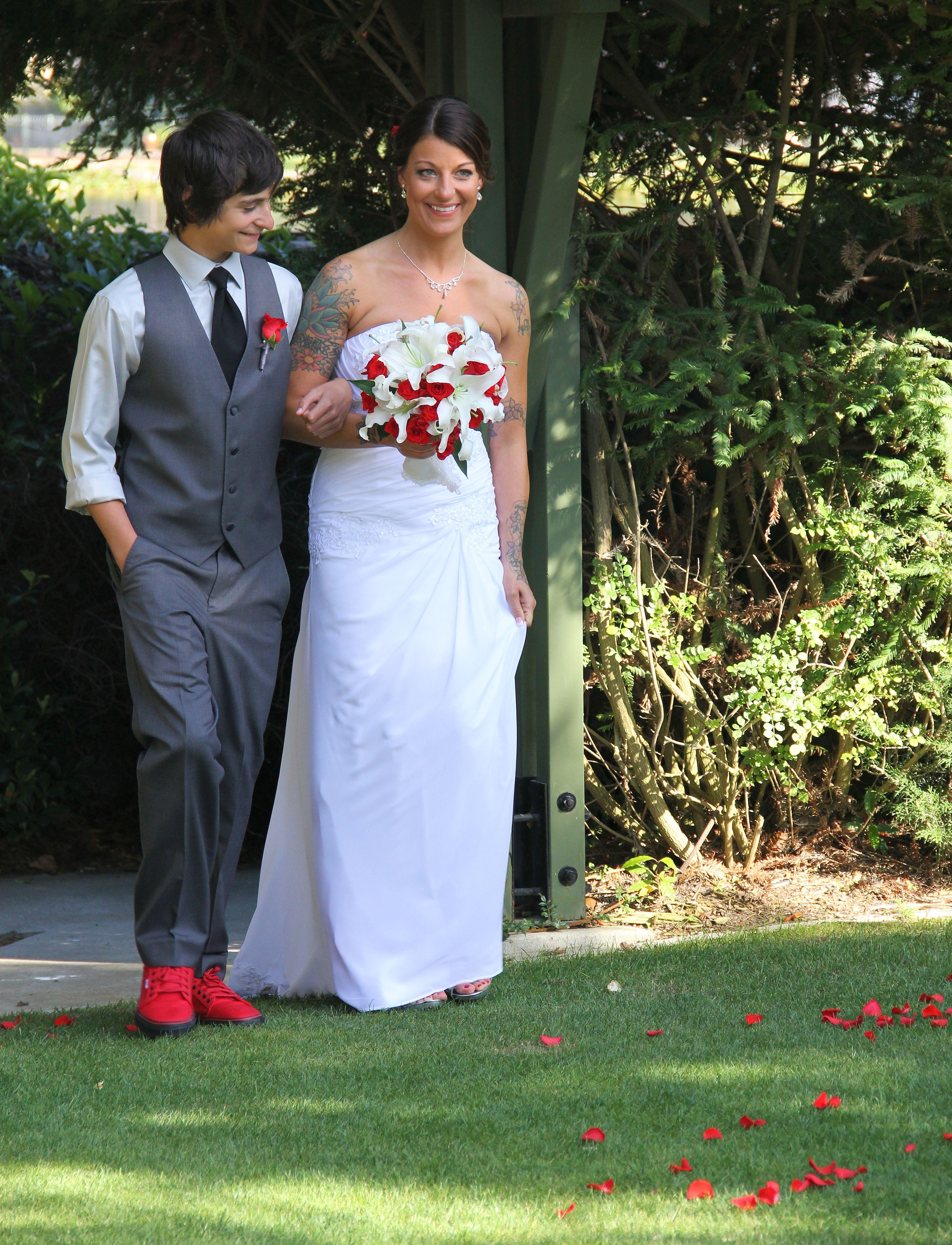 bride walking with son