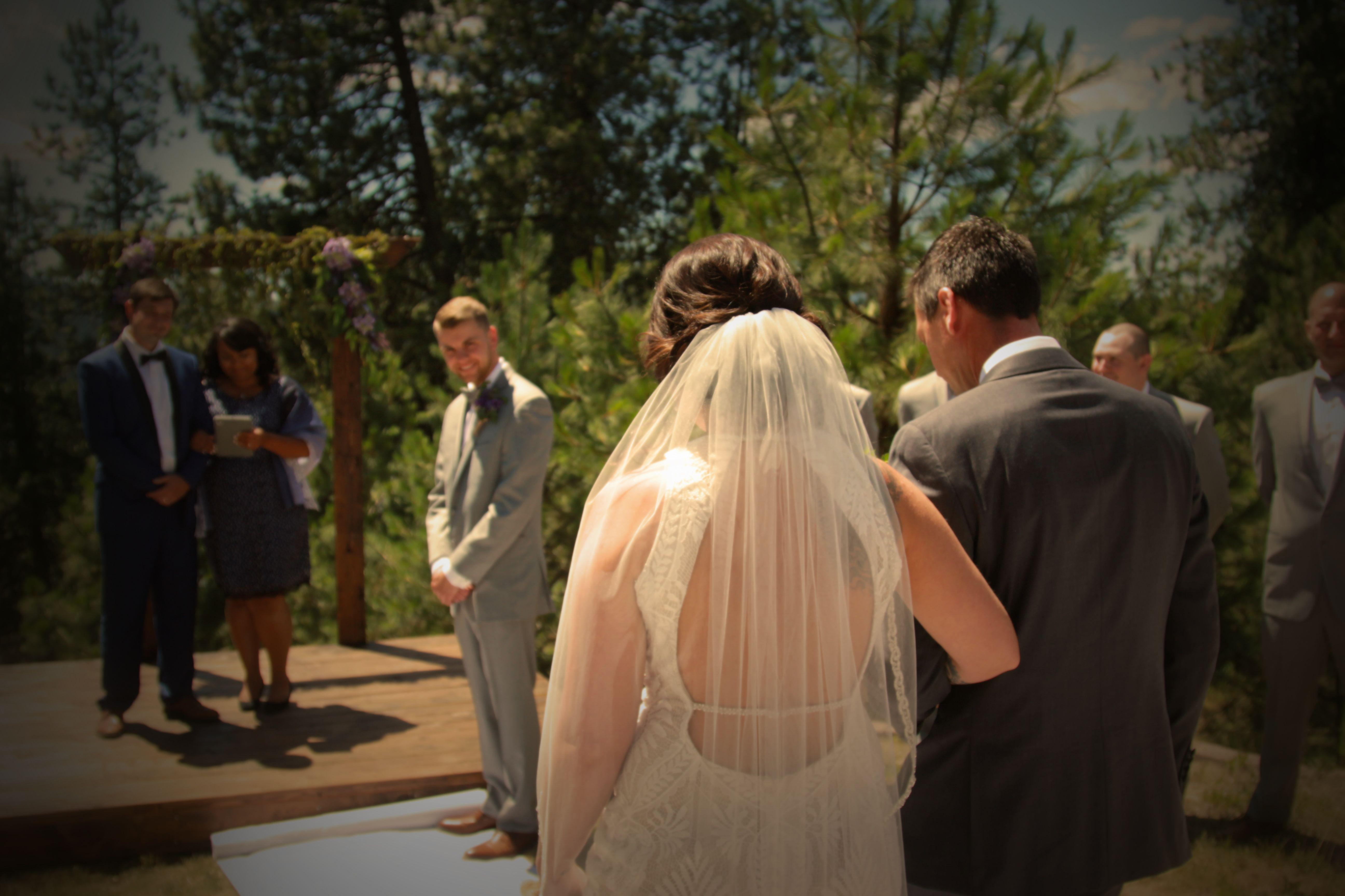 bride and dad walking toward alter