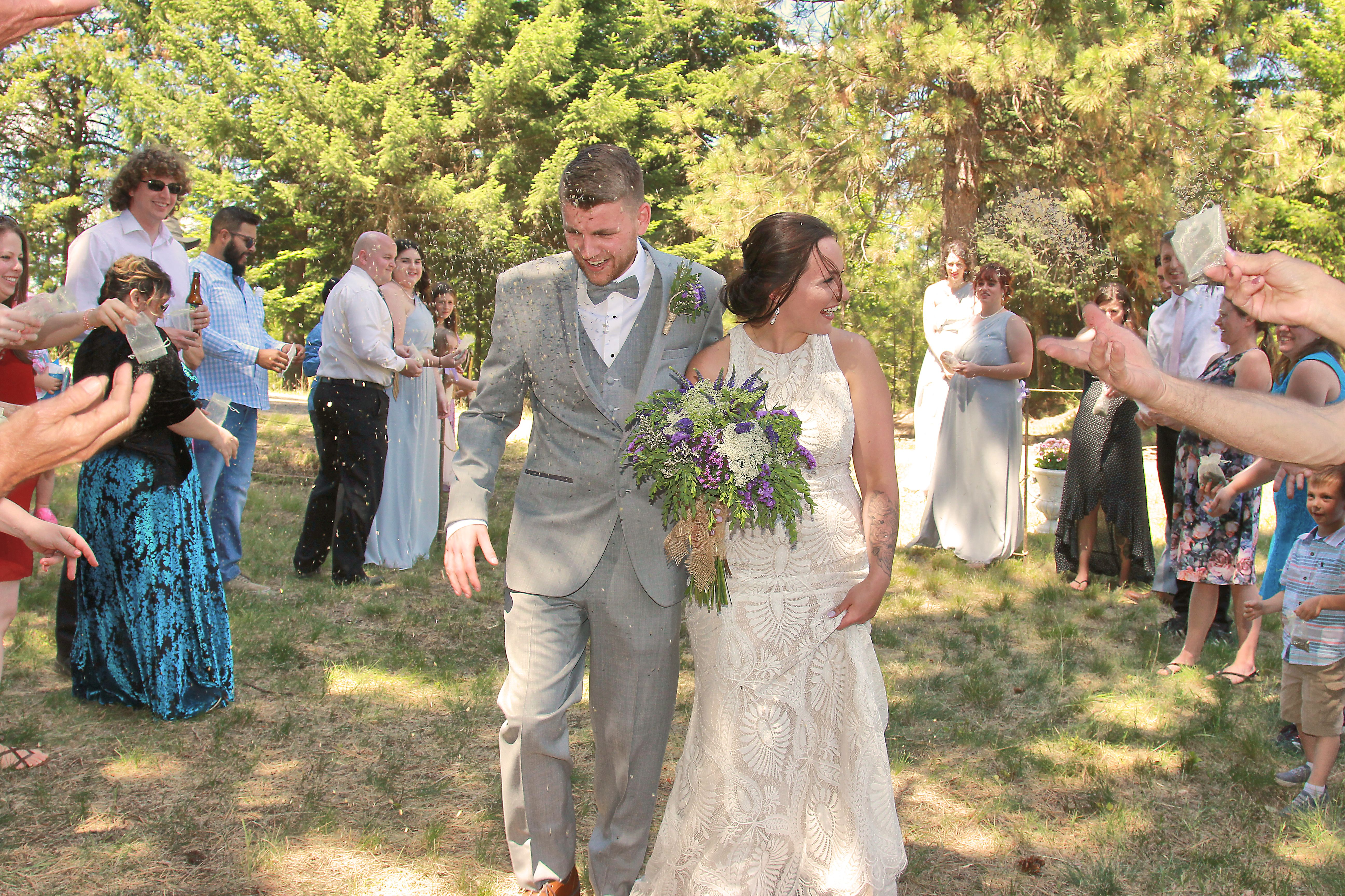 wedding guest tossing lavender